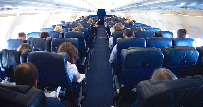 A Loving Stranger Assists A Mom Struggling With 2 Kids on Charlotte flight