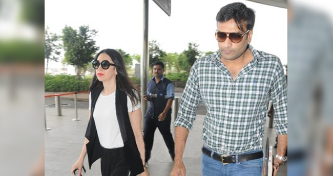 Pics: Karisma Kapoor spotted with alleged beau Sandeep Toshniwal at the airport