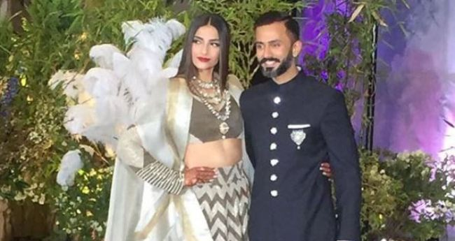 First Pics Out! Sonam and Anand Make A Stylish Entry At Their Wedding Reception