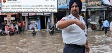 A Punjab Police Officer Does Duty In Knee-Deep Rainwater, Gains Appreciation