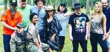 Priyanka Chopra sits on Nick Jonas' lap as the couple pose for a pic