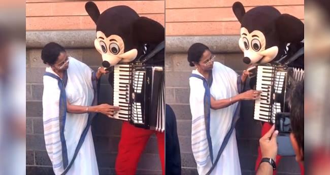 Mamata Banerjee Beautifully Played Hum Hongey Kamyaab On Mickey Mouse's Accordian On The Streets Of Germany