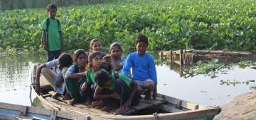 Students living in slum have to take efforts to reach school in Delhi via boats