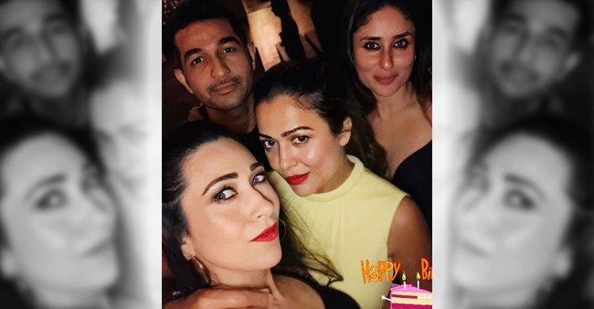 Kareena Kapoor looks like a real diva as she poses with Amrita and Karisma