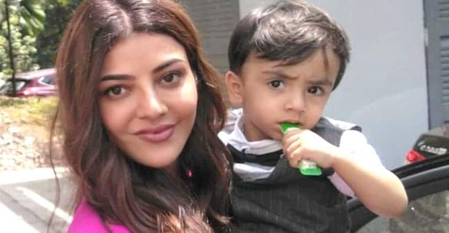 Throwback: Kajal Aggarwal looks adorable as she poses with a little fan in her arms